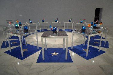 GOLDEN STARS 'MEDIA FOOD (1994-2014). Unique piece. Variable measures according to space. Intermedia piece. 12 tables (75 x 75 cm)