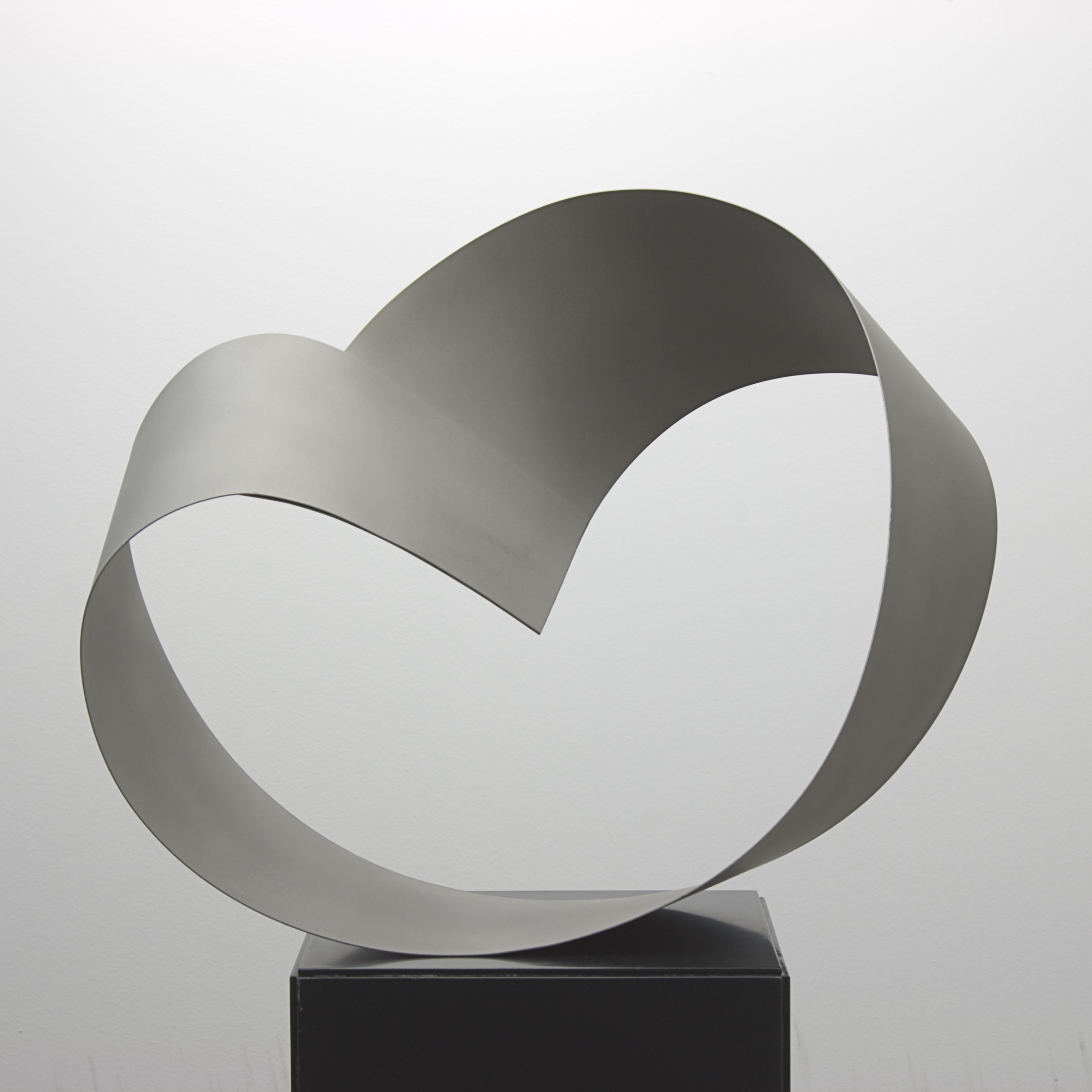 Moebius3.  2013. Stainless steel sheet. Sprayed aluminium silicate treatment. 32 x 40 x 24 cm.