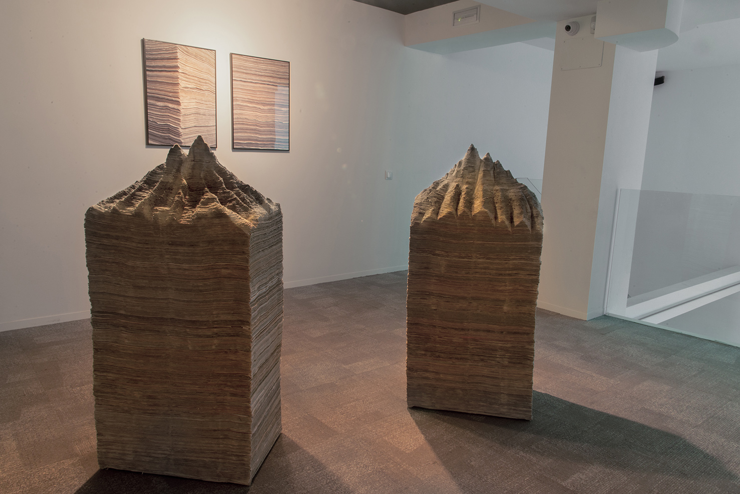 Exhibition view.  Mountain of newspapers III and IV, 2014. Newspapers. 126 x 59 x 41 cm